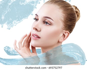 Beautiful woman in splashes of clear blue water. Cleansing and moisturizing concept. Over white background.