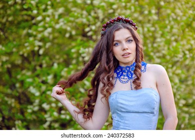 beautiful woman in a spring wreath.
