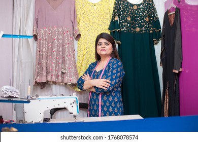 Beautiful woman standing with arms crossed in a fashion store
