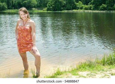 A beautiful woman standing in a lake.