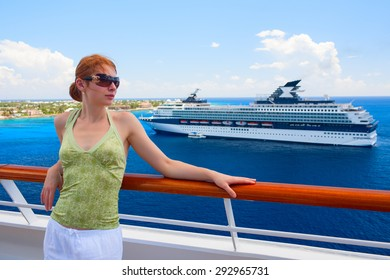 Beautiful woman is standing on the open deck of luxury cruise ship. Grand Cayman island