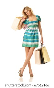beautiful woman standing with shopping bags