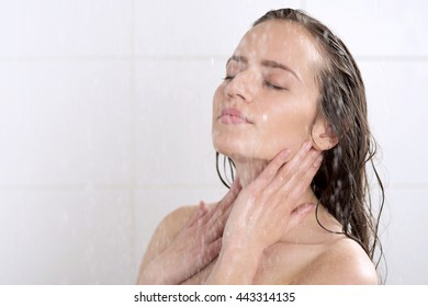 a beautiful woman standing at the shower
