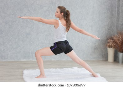 Beautiful Woman Standing Yoga Extended Pose Stretch two arm hand in Home
