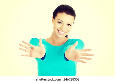 Beautiful woman with stretched hands and showing her palms.