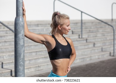 beautiful woman stretching her arms and shoulders in city