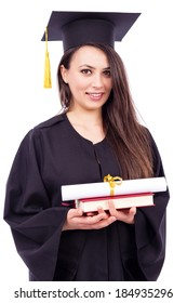 Beautiful woman student in graduation gown holding book and  diploma against white background