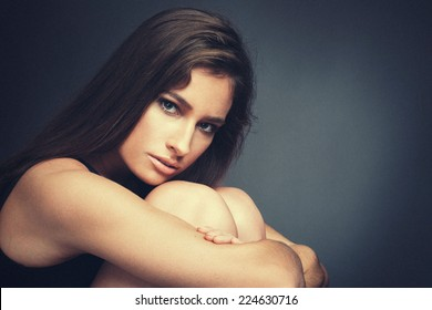 beautiful woman studio portrait in dark light with old effect and classic light