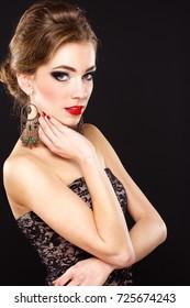 Beautiful woman with stylish accessories, closeup.beautiful ears with earrings handmade
