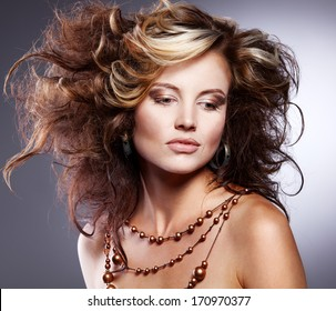 Beautiful woman with stylish hairstyle with jewelry