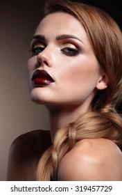 Beautiful woman with stylish make-up, vinous lips . Beauty face.