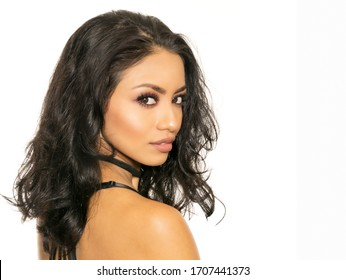 Beautiful woman with sultry sexy makeup style isolated against white background