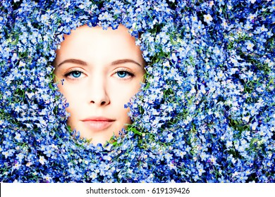 Beautiful Woman in Summer Flowers Background. Female Face with Make up
