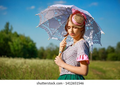 beautiful woman in summer in nature with a beautiful umbrella.