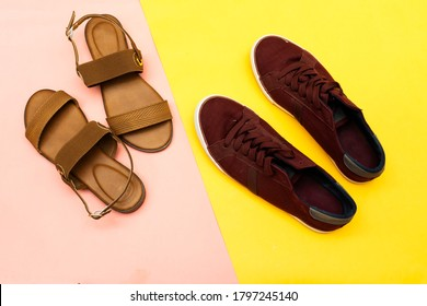 beautiful woman summer sundal  and man sneakers isolated on yellow background