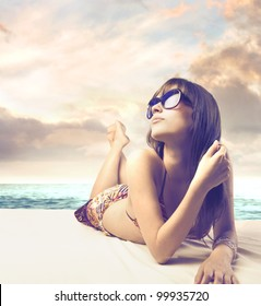 Beautiful woman sunbathing at the seaside