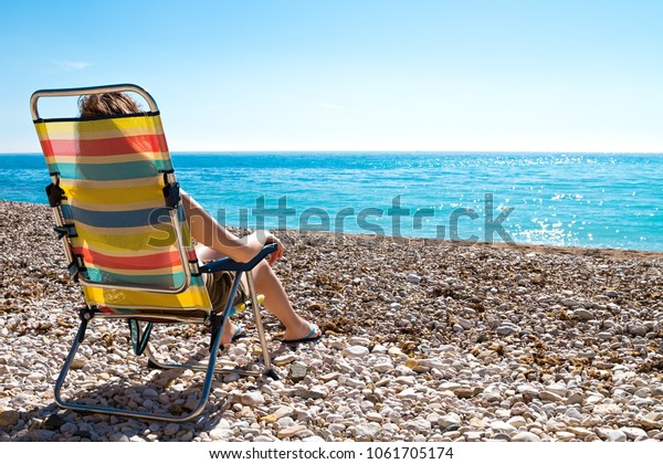 Magnificent Beautiful Woman Sunbathing Sitting On Folding Stock Photo Gmtry Best Dining Table And Chair Ideas Images Gmtryco