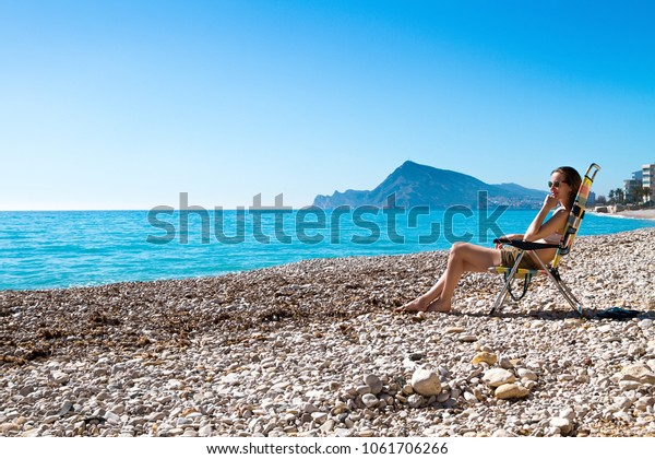 Peachy Beautiful Woman Sunbathing Sitting On Folding Stock Photo Gmtry Best Dining Table And Chair Ideas Images Gmtryco