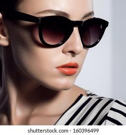 The beautiful woman in sunglasses