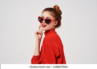 beautiful woman in sunglasses in the form of hearts