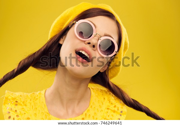 beautiful woman in sunglasses and take a yellow portrait background