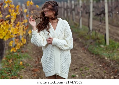 Beautiful woman in a sweater in the fall