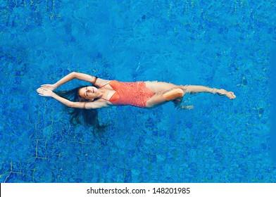 beautiful woman in the swimming pool - top view