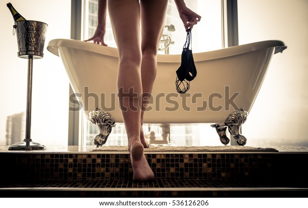 Beautiful woman taking bath in her beautiful tub