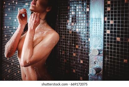 Beautiful woman taking shower in her bathroom