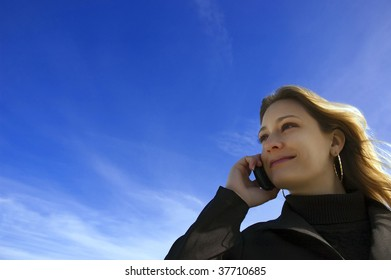 beautiful woman talking at mobile phone