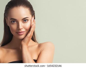 Beautiful woman tanned skin natural make up fresh skin fashion healthyspa hair and skin female portrait