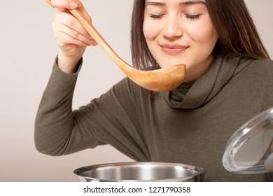 beautiful woman tasting food