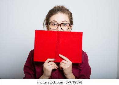 Beautiful woman teacher in glasses with books isolated on a gray background
