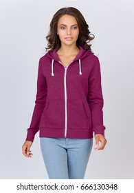 Beautiful woman in the template of a women's sweatshirt of crimson color