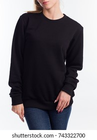 Beautiful woman in the template of a women's sweatshirt of black color
