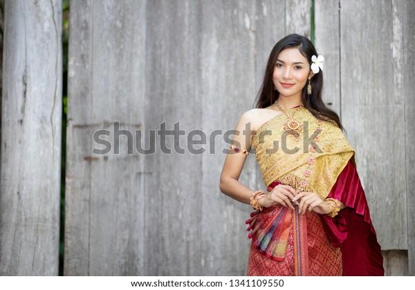 https://image.shutterstock.com/image-photo/beautiful-woman-thai-national-costume-600w-1341109550.jpg