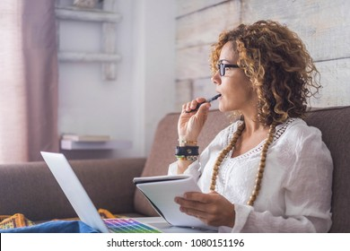 beautiful woman think and write notes on paper working on a laptop freedom from office at home. alternative lifestyle and place to work on. Nice life daily scene