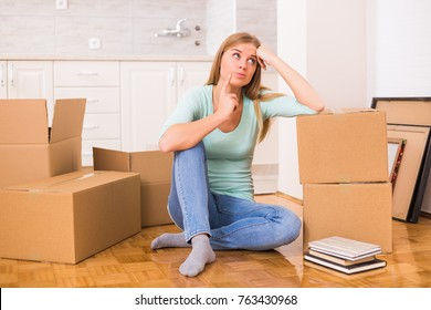 Beautiful woman is thinking about organization in her new home.