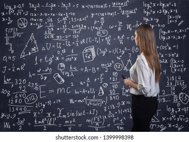 Beautiful woman thinking how to solve a math problem