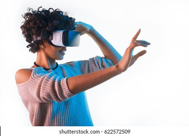 Beautiful woman touching air during the VR experience isolated on white.