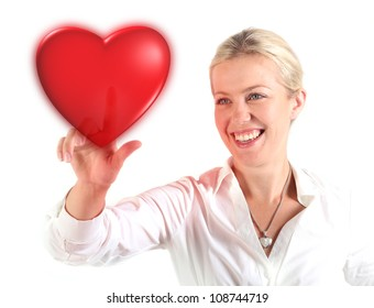 Beautiful woman touching a heart with finger