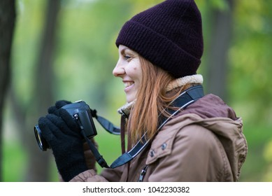 beautiful woman tourist travel photographer photographing forest at autumn day Odessa