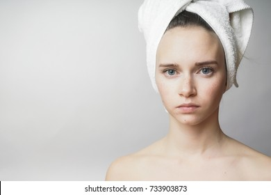Beautiful woman with towel on the head looking to camera,smile