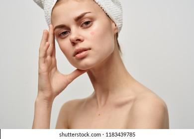 beautiful woman towel on her head bare shoulders