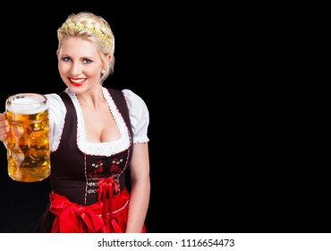 beautiful woman in a traditional bavarian dirndl with a beer