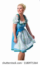 beautiful woman in a traditional bavarian dirndl isolated on white