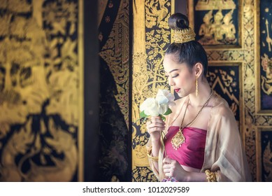 Beautiful woman in traditional dress costume,Asian woman wearing typical Thai dress identity culture of Thailand