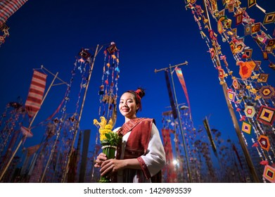 Beautiful woman in traditional dress costume,Asian woman wearing typical Thai dress identity culture of Thailand at night.