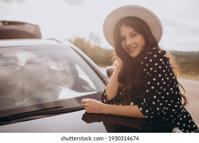 Beautiful woman traveling by car