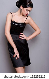 beautiful woman with trendy make-up in evening dress